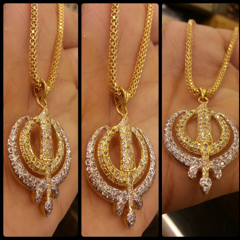 Gold chain khanda n white crystal stones gold chain khanda n white crystal stones mozeypictures Images